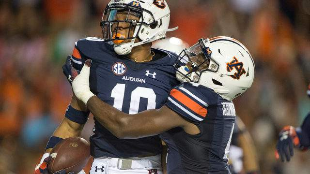 Running back Devan Barrett #10 of the Auburn Tigers celebrates with wide receiver Noah Igbinoghene #4 of the Auburn Tigers after scoring a touchdown during their game against the Alabama State Hornets in the second quarter at Jordan-Hare Stadium on September 8, 2018 in Auburn, Alabama. (Photo by Michael Chang/Getty Images)