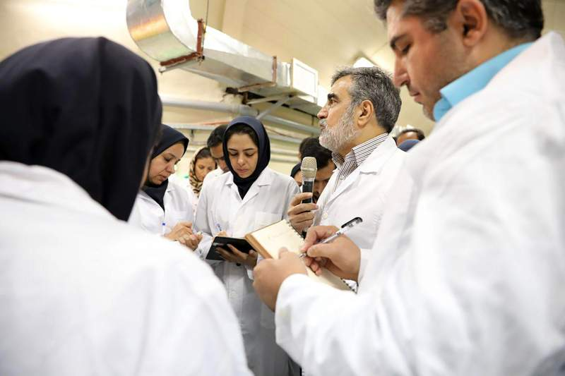 In this photo released by the Atomic Energy Organization of Iran, spokesman of the organization Behrouz Kamalvandi, center, briefs the media while visiting Fordo nuclear site near Qom, south of Tehran, Iran Saturday, Nov. 9, 2019. Joe Biden has an Iran problem. And, its getting more complicated by the day. Thanks to provocative moves by Iran and less-than-coherent actions by the outgoing Trump administration, the president-elect is facing an increasingly uncertain situation when it comes to Iran, a decades-long American nemesis that has been a target of blame for much of the Middle East's instability, (Atomic Energy Organization of Iran via AP)