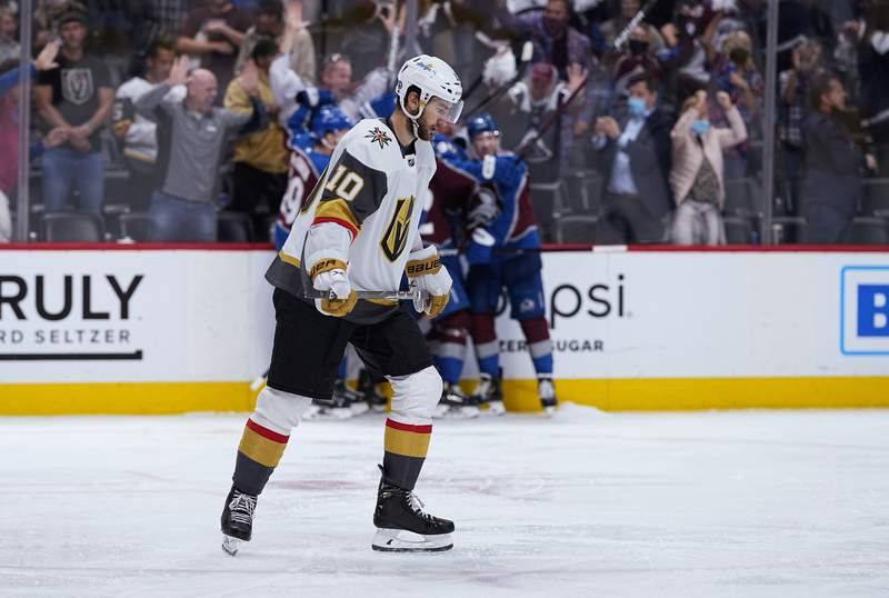 Vegas Golden Knights center Nicolas Roy (10) reacts after the team's 3-2 loss to the Colorado Avalanche in overtime in Game 2 of an NHL hockey Stanley Cup second-round playoff series Wednesday, June 2, 2021, in Denver. (AP Photo/Jack Dempsey)