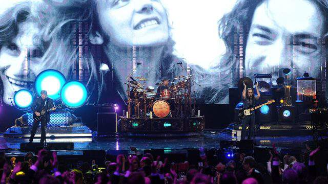 Inductees Alex Lifeson, Neil Peart and Geddy Lee of Rush perform onstage at the 28th Annual Rock and Roll Hall of Fame Induction Ceremony at Nokia Theatre L.A. Live on April 18, 2013 in Los Angeles, California. (Photo by Kevin Winter/Getty Images)