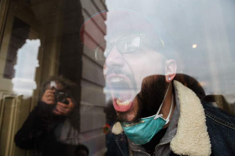 A member of a pro-Trump mob screams out at the crowd from the inside the Capitol Building after breaking in on Jan. 6, 2021 in Washington, D.C.