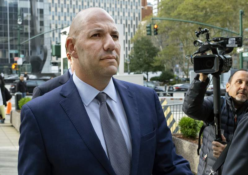 FILE - In this Oct. 17, 2019, file photo, David Correia walks from federal court in New York. In court papers filed late Monday, Feb. 1, 2021, prosecutors say Correia, a fraudster facing sentencing the following week, lured one investor by bragging that Rudy Giuliani had agreed to be the face of a fraud-busting company that was a fraud itself. (AP Photo/Craig Ruttle, File)