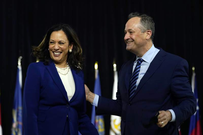 Sen. Kamala Harris, D-Calif., and her husband Douglas Emhoff look over to Democratic presidential candidate former Vice President Joe Biden and his wife Jill Biden after a campaign event at Alexis Dupont High School in Wilmington, Del., Wednesday, Aug. 12, 2020. (AP Photo/Carolyn Kaster)