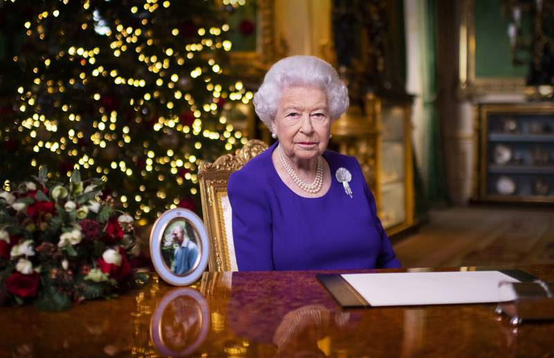 In this undated photo issued on Friday Dec. 25, 2020, Britain's Queen Elizabeth II records her annual Christmas broadcast in Windsor Castle, Windsor, England. (Victoria Jones/Pool via AP)