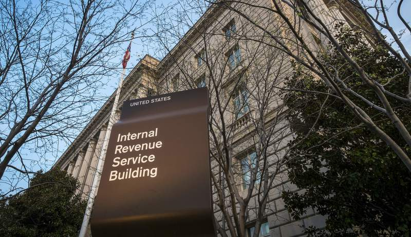 FILE - In this April 13, 2014 file photo, the Internal Revenue Service Headquarters (IRS) building is seen in Washington. More than 50 of the largest U.S. companies paid nothing in federal income taxes last year, even though they reported big pretax profits as a group. That's according to the Institute on Taxation and Economic Policy, a group that believes the tax system needs to raise more revenue. (AP Photo/J. David Ake, File)