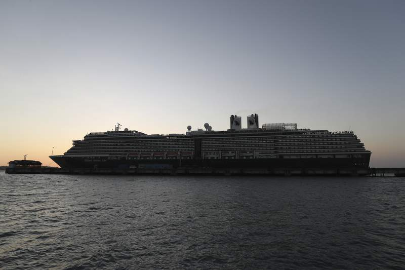The Westerdam cruise ship, owned by Holland America Line, is docked at the port of Sihanoukville, Cambodia, Thursday, Feb. 13, 2020. The Westerdam, turned away by four Asian and Pacific governments due to virus fears, anchored Thursday off Cambodia for health checks on its 2,200 passengers and crew. (AP Photo/Heng Sinith)