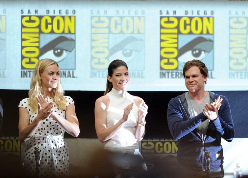 "SAN DIEGO, CA - JULY 18:  Actors Yvonne Strahovski, Jennifer Carpenter, and Michael C. Hall speak onstage at Showtime's ""Dexter"" panel during Comic-Con International 2013 at San Diego Convention Center on July 18, 2013 in San Diego, California.  (Photo by Kevin Winter/Getty Images)"