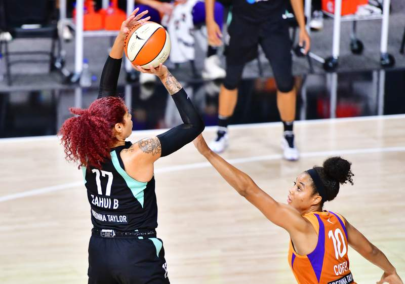 PALMETTO, FLORIDA - AUGUST 02: Amanda Zahui B #17 of the New York Liberty draws the foul from Nia Coffey #10 of the Phoenix Mercury during the second half of a game at Feld Entertainment Center on August 02, 2020 in Palmetto, Florida. NOTE TO USER: User expressly acknowledges and agrees that, by downloading and or using this photograph, User is consenting to the terms and conditions of the Getty Images License Agreement. (Photo by Julio Aguilar/Getty Images)