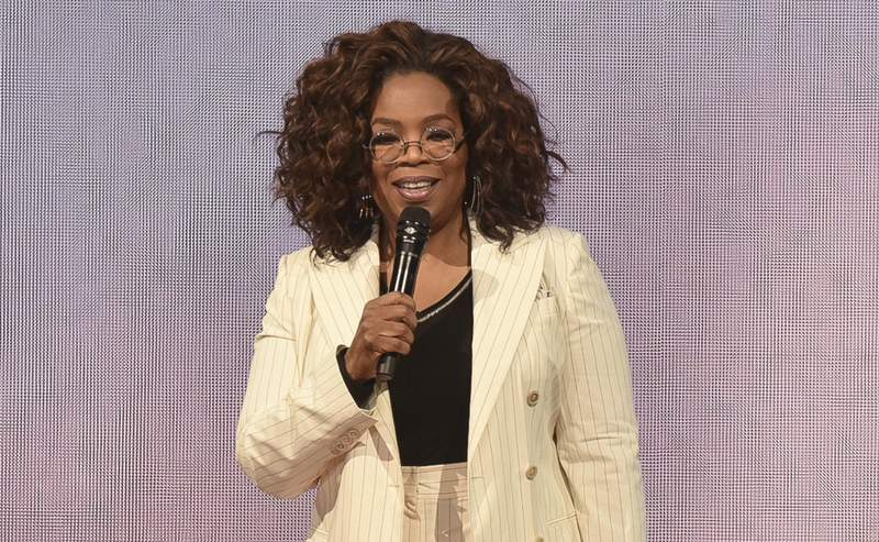 """FILE - Oprah Winfrey makes opening remarks during """"Oprah's 2020 Vision"""" tour on Feb. 29, 2020, in Inglewood, Calif. Winfrey will have a biographical documentary released on Apple TV+. The streaming platform announced Thursday, Jan. 14, 2021, that the two-part documentary will focus on Winfrey's life. (Photo by Richard Shotwell/Invision/AP, File)"""