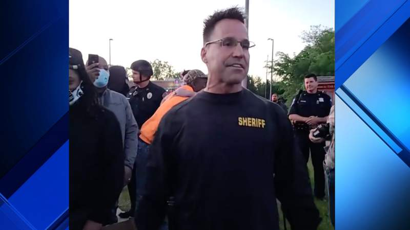Genesee County Sheriff Chris Swanson joins protestors in Flint on May 30, 2020. Photo courtesy of Facebook video by Avis Sword.