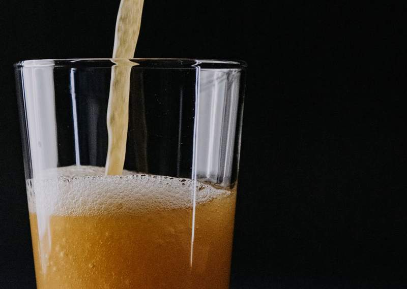 Beer being poured into a glass.