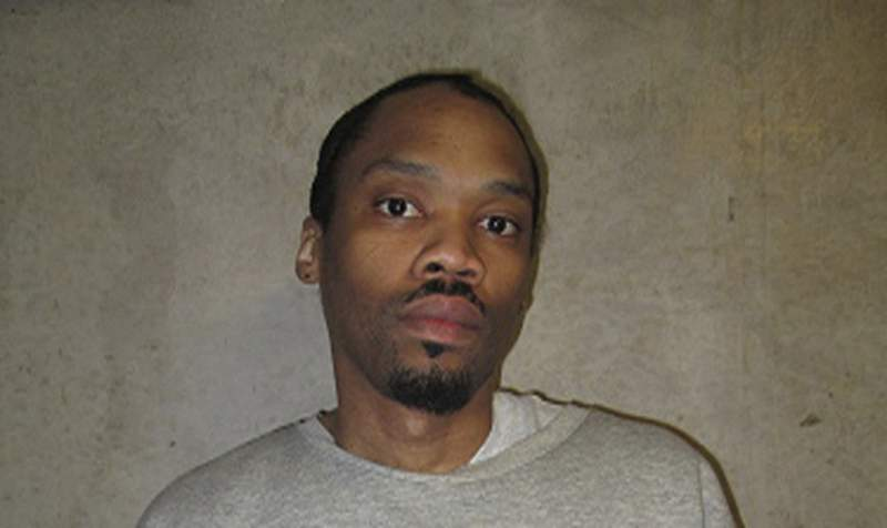 FILE - This undated file photo released by Oklahoma Department of Corrections shows Julius Jones. Oklahoma County's top prosecutor is asking the state's Pardon and Parole Board to reject a commutation request from Jones. Jones' case has drawn national attention and he's scheduled for a commutation hearing next week. Jones was convicted and sentenced to die for the 1999 shooting death of Edmond businessman Paul Howell. (Oklahoma Department of Corrections via AP File)