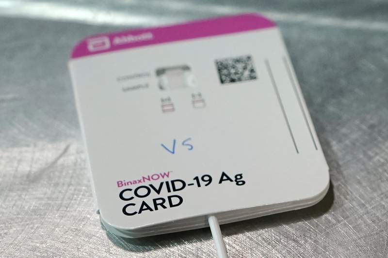 FILE - This Wednesday, Feb. 3, 2021 file photo shows a BinaxNOW rapid COVID-19 test made by Abbott Laboratories, in Tacoma, Wash. On Wednesday, March 31, 2021, the FDA said Abbotts BinaxNow and Quidels QuickVue tests can now be sold without a prescription for consumers to test themselves repeatedly at home. (AP Photo/Ted S. Warren)