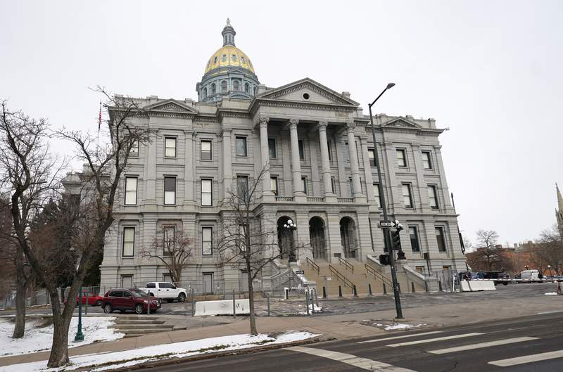 FILE - The State Capitol is shown in this file photo taken Monday, Dec. 14, 2020, in downtown Denver. Colorado Democrats have condemned statements from a Republican state Representative about lynching and a slavery-era policy that he said was not racist. Republican Rep. Ron Hanks made his comments on the House floor Thursday, April 15, 2021, about a bill aimed to strengthen civics education in schools. (AP Photo/David Zalubowski, File)