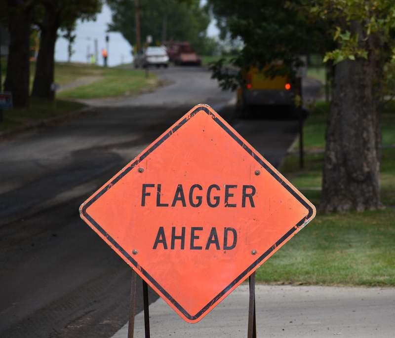 Road flagger sign.