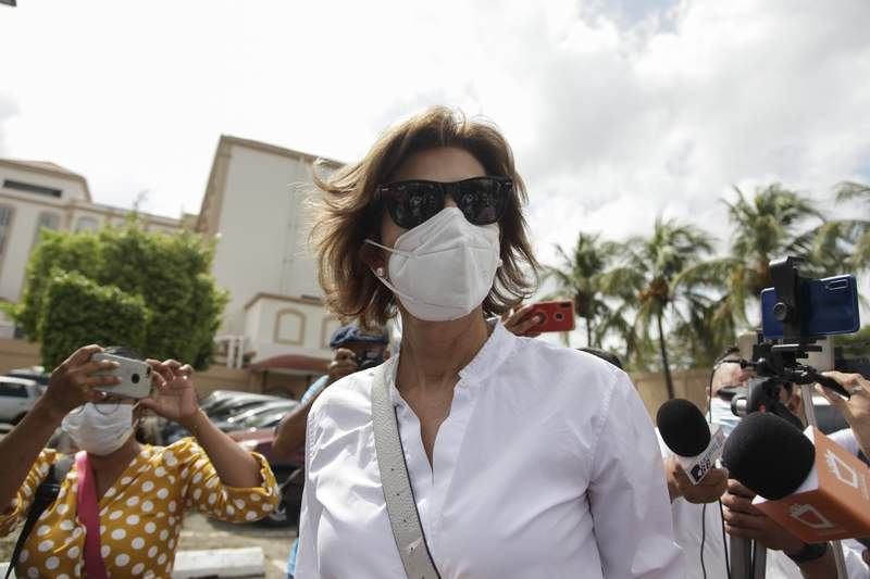 """Cristiana Chamorro, former director of the Violeta Barrios de Chamorro Foundation for Reconciliation and Democracy, and daughter of a former president, arrives at the public Ministry where she was called for a meeting to explain alleged """"inconsistencies"""" in financial reports filed with the government between 2015 and 2019 in Managua, Nicaragua, Friday, May 21, 2021. After the meeting, she accused President Daniel Ortega of ordering that evidence be fabricated against her. (AP Photo/Diana Ulloa)"""