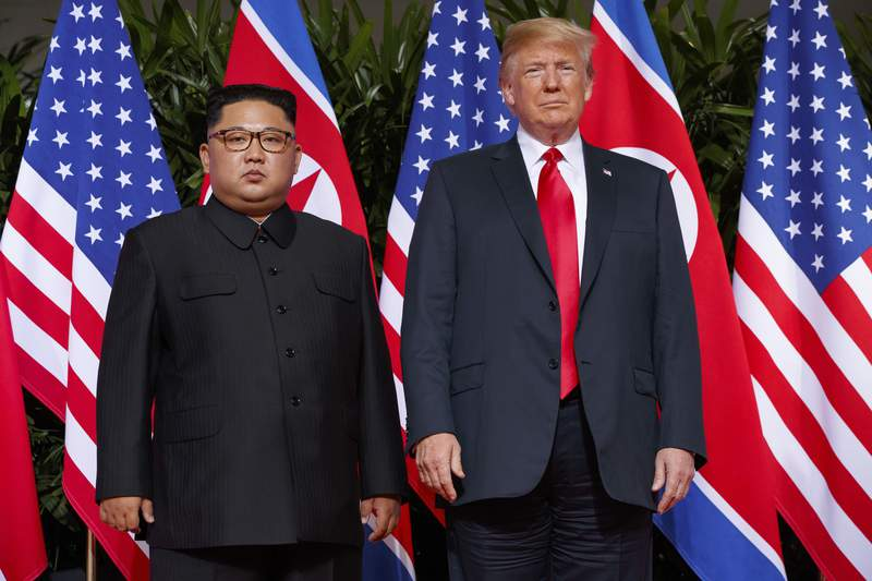FILE - In this June 12, 2018, file photo, U.S. President Donald Trump, right, meets with North Korean leader Kim Jong Un on Sentosa Island, in Singapore. The U.S. strike that killed Irans top military commander may have had an indirect casualty: a diplomatic solution to denuclearizing North Korea. Experts say the escalation of tensions between Washington and Tehran will diminish already fading hopes for such an outcome and inspire North Koreas decision-makers to tighten their hold on the weapons they see, perhaps correctly, as their strongest guarantee of survival. (AP Photo/Evan Vucci, File)