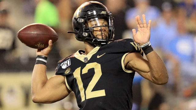 Jamie Newman #12 of the Wake Forest Demon Deacons drops back to pass against the North Carolina Tar Heels during their game at BB&T Field on September 13, 2019 in Winston Salem, North Carolina. (Photo by Streeter Lecka/Getty Images)