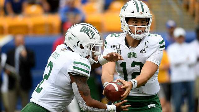 Nathan Rourke #12 of the Ohio Bobcats hands off to Julian Ross #2 in the first quarter during the game against the Pittsburgh Panthers at Heinz Field on September 7, 2019 in Pittsburgh, Pennsylvania. (Photo by Justin Berl/Getty Images)