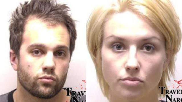 Brian Conrad, 28, and Nicole Hastings, 30, were arrested Tuesday in possession of large amounts of meth, fake money, and an unregistered handgun. (Traverse Narcotics Team/WPBN)