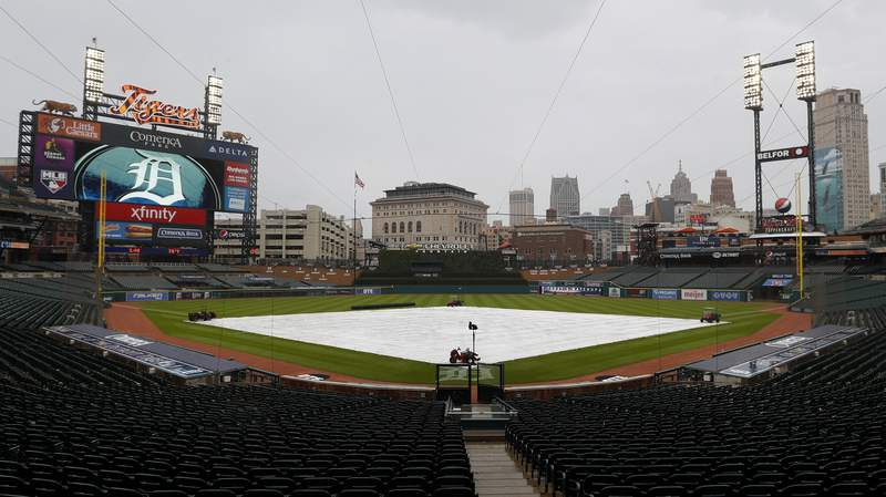 The tarp on the field at Comerica Park. (AP Photo/Paul Sancya)