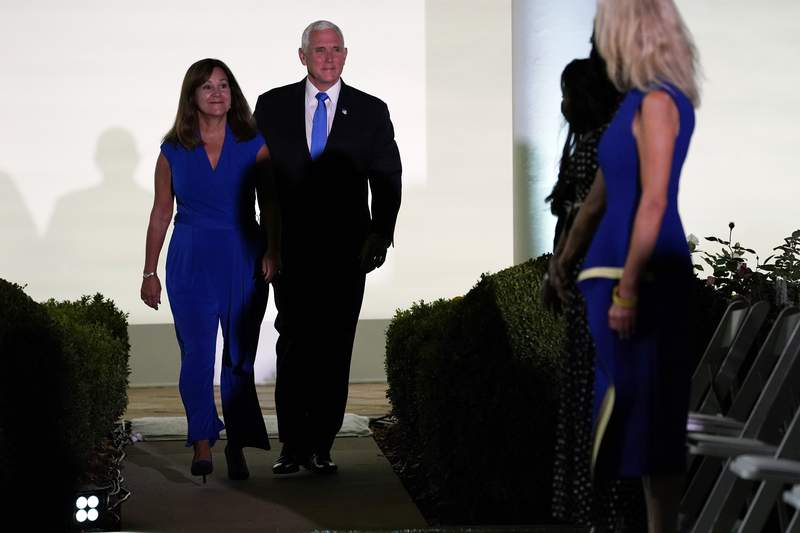 Vice President Mike Pence and second lady Karen Pence arrive to listen to first lady Melania Trump to speak during the 2020 Republican National Convention from the Rose Garden of the White House, Tuesday, Aug. 25, 2020, in Washington. (AP Photo/Evan Vucci)