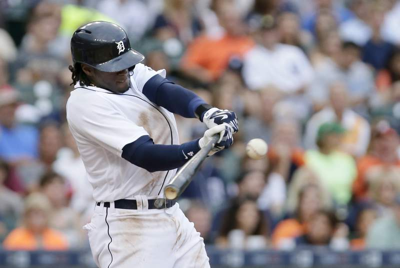Cameron Maybin #4 of the Detroit Tigers doubles to drive in two runs against the Houston Astros during the second inning at Comerica Park on July 29, 2016 in Detroit, Michigan.