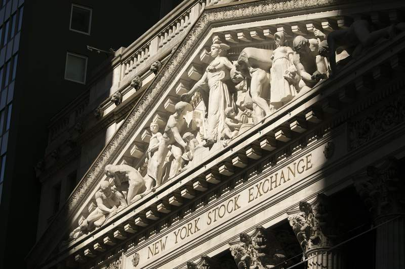 FILE - This July 21, 2020 file photo shows the New York Stock Exchange.  Stocks are drifting close to their record heights in early trading on Wall Street Tuesday, Aug. 25,  after the United States and China indicated some progress in trade talks.   (AP Photo/Mark Lennihan, File)