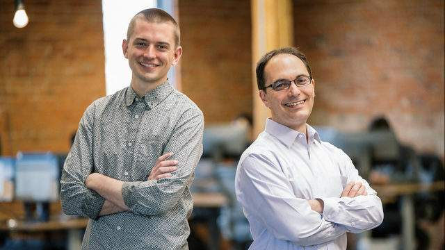 CTO Brian Moore and CEO Jason Corso pose for a photo at the Voxel51 offices in Kerrytown Shops. (Courtesy: Voxel51)