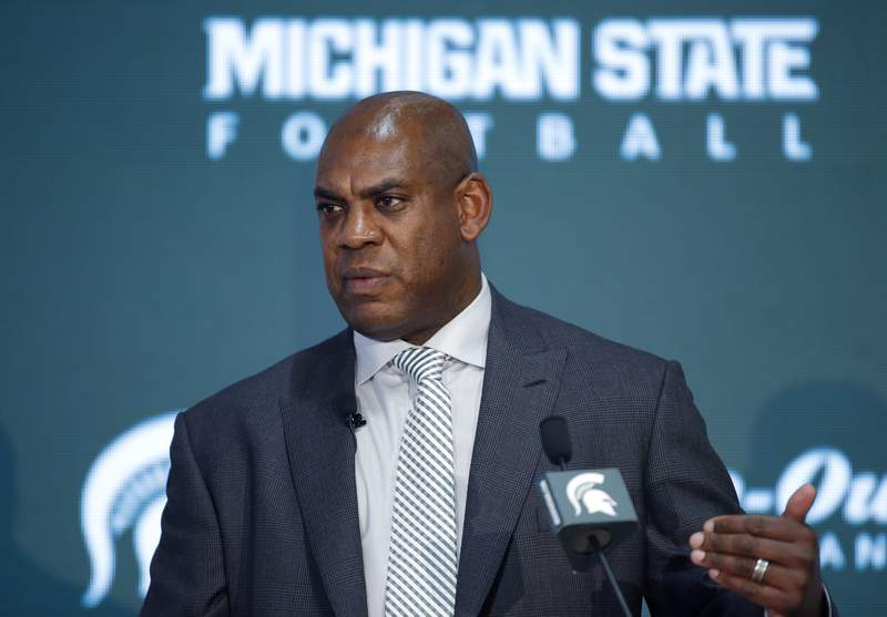 FILE - In this Wednesday, Feb. 12, 2020, file photo, Mel Tucker, Michigan State's new football coach, speaks during an introductory news conference in East Lansing, Mich. Big Ten is going to give fall football a shot after all.  Less than five weeks after pushing football and other fall sports to spring in the name of player safety during the pandemic, the conference changed course Wednesday, Sept. 16, 2020, and said it plans to begin its season the weekend of Oct. 23-24. (AP Photo/Al Goldis, File)
