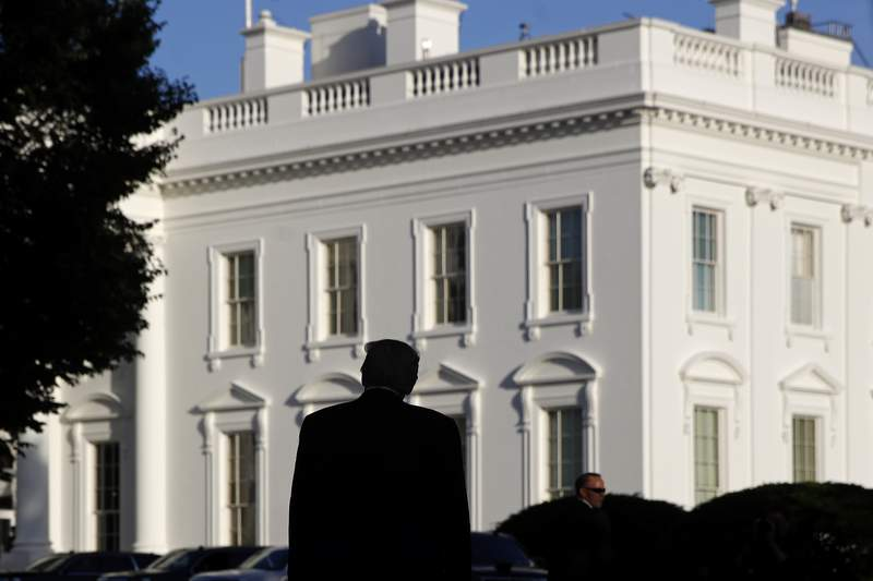 FILE - In this June 1, 2020, file photo President Donald Trump returns to the White House after visiting outside St. John's Church in Washington. President Donald Trump's vows to restore law and order and to protect what he's called the Suburban Lifestyle Dream draw from a decades-old playbook in Republican politics. (AP Photo/Patrick Semansky, File)