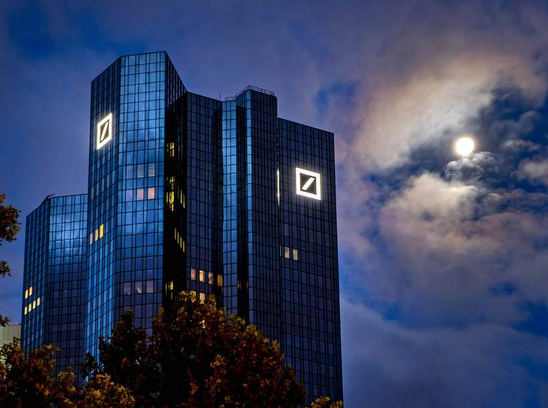 FILE  In this Oct. 4, 2020, file photo, the moon shines next to the headquarters of the Deutsche Bank in Frankfurt, Germany. Deutsche Bank releases first-quarter earnings on Wednesday. (AP Photo/Michael Probst, File)
