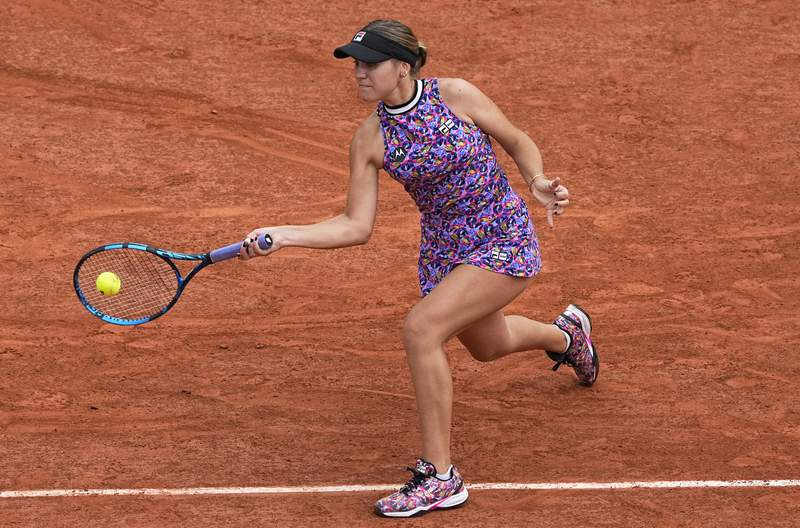FILE - In this June 5, 2021, file photo, United States' Sofia Kenin plays a return to countrywoman Jessica Pegula at the French Open tennis tournament at Roland Garros in Paris. Kenin pulled out of the U.S. Open on Wednesday, Aug. 25, because she recently tested positive for COVID-19, even though she said she has received a vaccine. Kenin announced what she called disappointing news on social media. (AP Photo/Michel Euler, File)