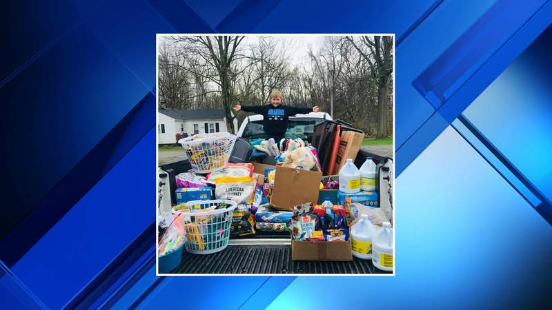 Dylan Lowrey with the supplies he purchased for the Romulus Animal Shelter.