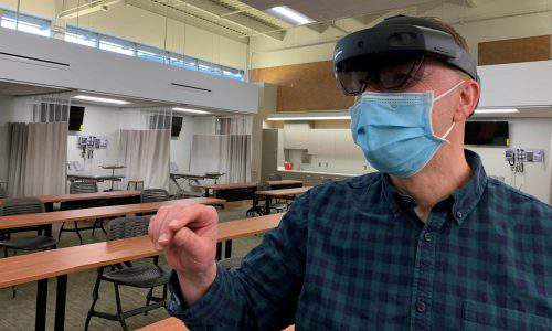 Ben Oliver, Concordia's Chief Simulation Specialist, demonstrates the AR headset.