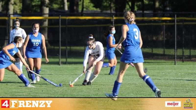 Joyce Di Pietro playing field hockey for Edsel Ford High School.