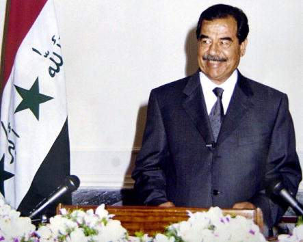 Iraqi President Saddam Hussein speaks on a national television April 8, 2002 in Baghdad. Hussein announced that he would suspend oil exports for one month in protest of the Israeli incursion into the Palestinian territories. (Photo by INA/Getty Images)