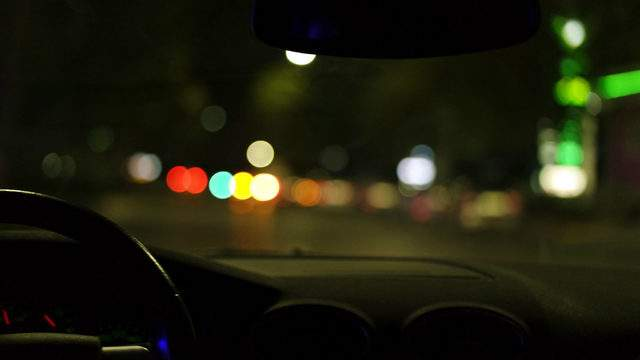 A person driving at night.