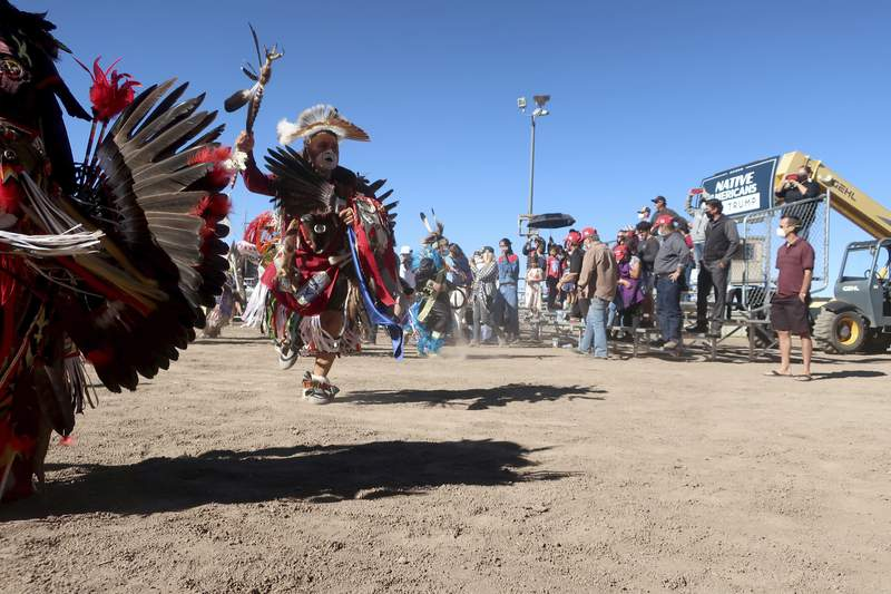 Native American dancers perform at a Donald Trump rally Oct. 15, 2020 at the rodeo grounds in Williams, Arizona. Navajo Nation President Myron Lizer makes no qualms about it: As one of the top officials on the country's largest Native American reservation, he's a proud Donald Trump supporter. Lizer says Native American values - hard work, family and ranching - align more with the GOP than with Democrats.   (AP Photo/Felicia Fonseca)