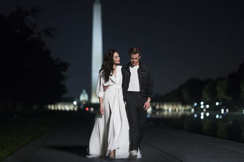 """This image released by Warner Bros. Entertainment shows Gal Gadot, left, and Chris Pine in a scene from """"Wonder Woman 1984."""" (Clay Enos/Warner Bros. via AP)"""
