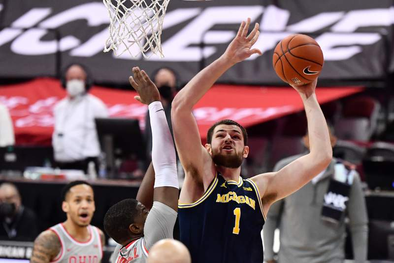 Hunter Dickinson #1 of the Michigan Wolverines drives to the basket in the second half against the Michigan Wolverines at Value City Arena in Columbus, Ohio on February 21, 2021. Michigan defeated Ohio State 92-87.