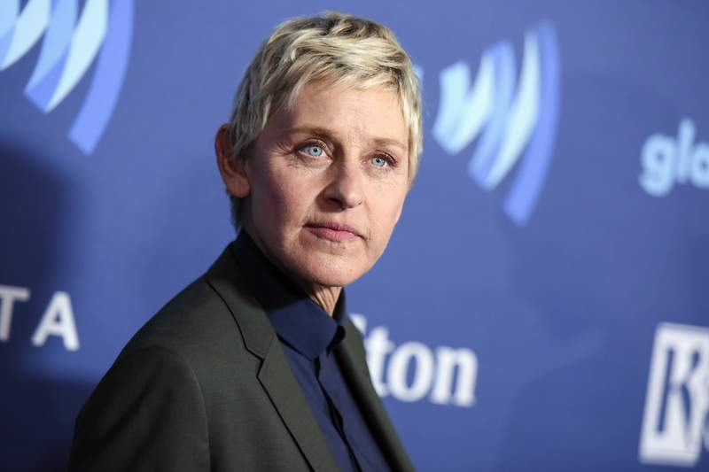 FILE - Ellen DeGeneres arrives at the 26th Annual GLAAD Media Awards in Beverly Hills, Calif., on March 21, 2015. DeGeneres said she has tested positive for COVID-19 but is feeling fine right now. The producer of her daytime talk show says production has been put on hold until January. (Photo by Richard Shotwell/Invision/AP, File)
