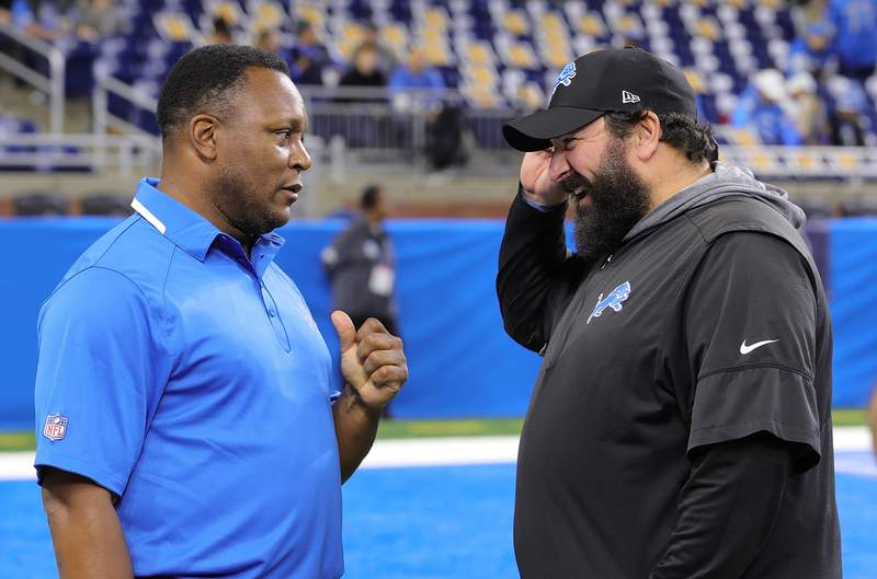 DETROIT, MI - NOVEMBER 28: Former Detroit Lions Barry Sanders talks with Head Coach Matt Patricia prior to the start of the game against the Chicago Bears at Ford Field on November 28, 2019 in Detroit, Michigan. (Photo by Leon Halip/Getty Images)