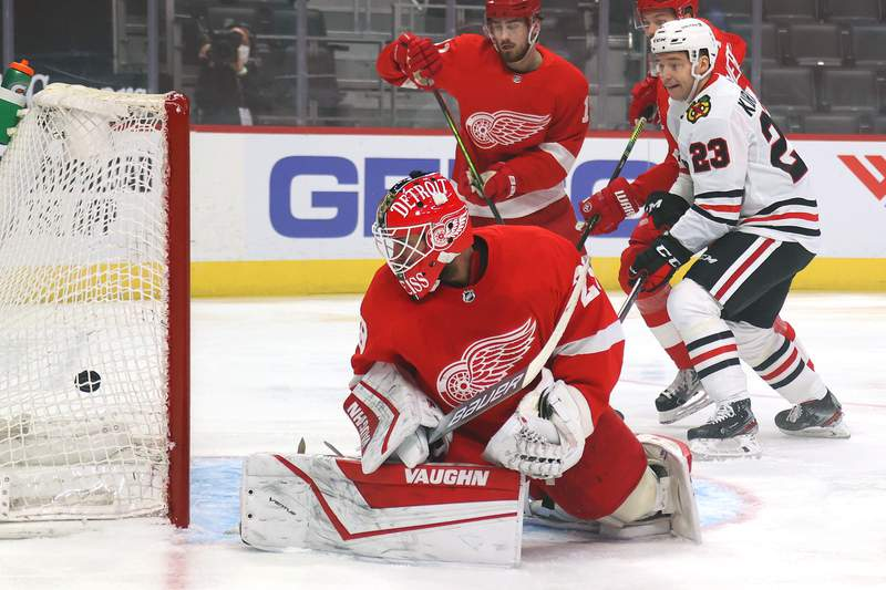 DETROIT, MICHIGAN - FEBRUARY 15: Thomas Greiss #29 of the Detroit Red Wings watches a first period goal get past him while playing the Chicago Blackhawks at Little Caesars Arena on February 15, 2021 in Detroit, Michigan. (Photo by Gregory Shamus/Getty Images)