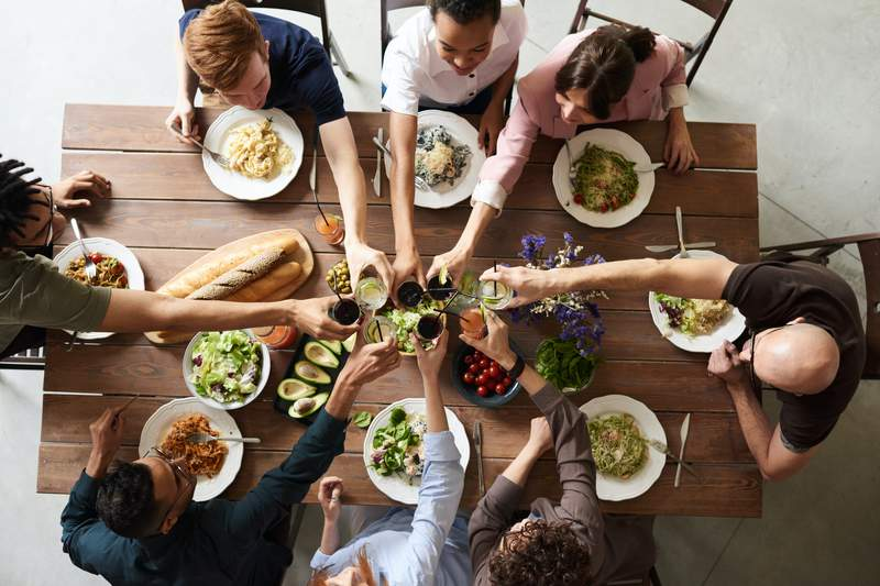 Group of People Eating Together.