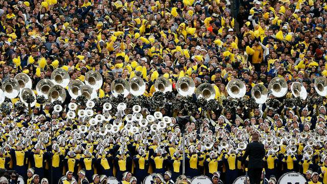 The Michigan Wolverines student section and marching band at Michigan Stadium in Ann Arbor, Michigan. (Christian Petersen/Getty Images)