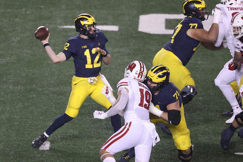 Cade McNamara #12 of the Michigan Wolverines throws a second half past against the Wisconsin Badgers at Michigan Stadium on November 14, 2020 in Ann Arbor, Michigan.