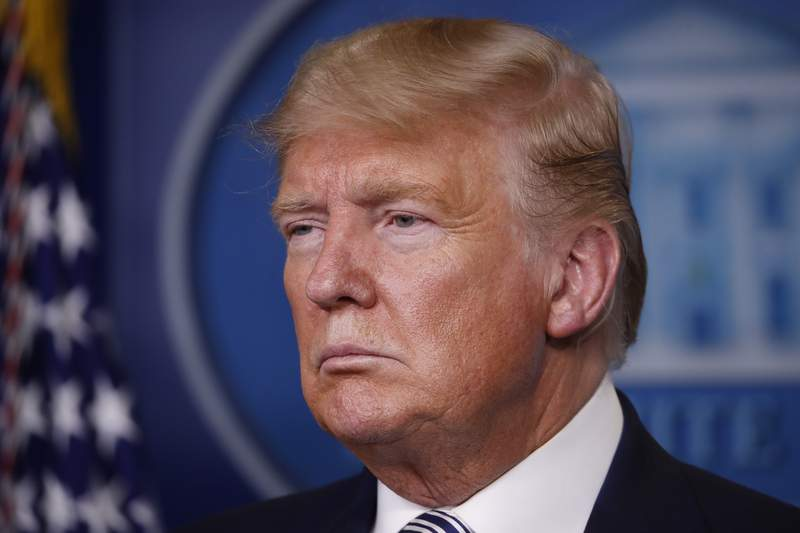 President Donald Trump listens during a briefing about the coronavirus in the James Brady Briefing Room, Monday, March 23, 2020, in Washington. (AP Photo/Alex Brandon)