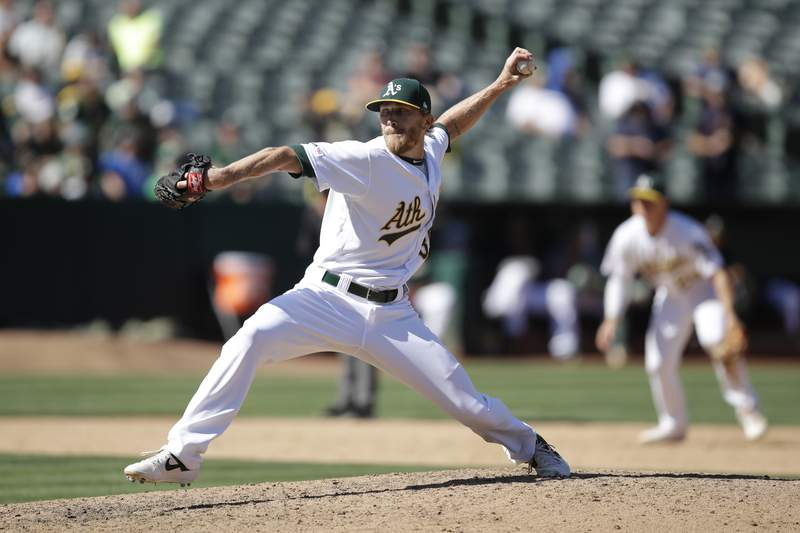 FILE: In this Sept. 5, 2019, file photo, Oakland Athletics pitcher Jake Diekman works against the Los Angeles Angels during a baseball game in Oakland, Calif. Diekman has serious questions about Major League Baseball's ability to pull off a season given the issues everywhere getting timely test results, forcing delays and cancellations of workouts. For now, Diekman still plans to play. He must be extra careful given he has the autoimmune condition ulcerative colitis. (AP Photo/Ben Margot, File)