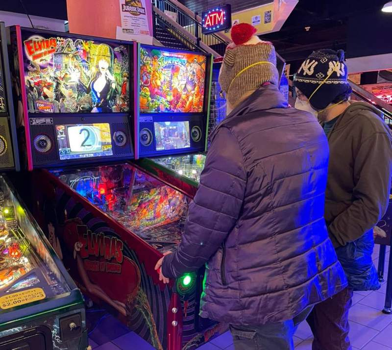 Players at the Ann Arbor Pinball Pete's on Dec. 26, 2020.